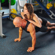 Man and a woman in the gym — Stock Photo #7549033