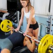 Man and a woman in the gym — Stock Photo #7565483