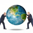 Two businessmen are holding the planet earth — Stock Photo