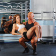 Man and a woman in the gym — Stock Photo #7662031