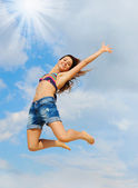 Beautiful Woman over blue Sky — Stock Photo