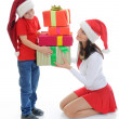 Cheerful boy in Santa Claus hat — Stock Photo #7690366