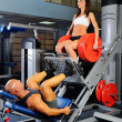 Man and a woman in the gym — Stock Photo #7725343