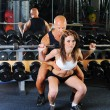 Stock Photo: Man and a woman in the gym