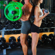 Man and a woman in the gym — Stock Photo #7727261