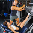 Man and a woman in the gym — Stock Photo #7727262