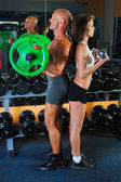 Man and a woman in the gym — Stock Photo