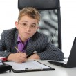 Young businessman using a laptop — Stock Photo #7885995