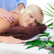 Young woman at spa procedure - 