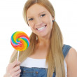 Happy curly woman with a lollipop — Stock Photo