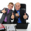 Stock Photo: Young businessman using a laptop