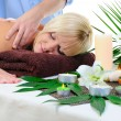 Young woman at spa procedure - Stock Photo