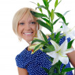 Woman with lily — Stockfoto