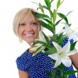 Woman with lily — Foto Stock