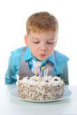 Beautiful little boy celebrates birthday — Stock Photo