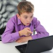 Boy at the computer — Stock Photo #7901034