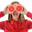 Beautiful girl with juicy orange — Stock Photo