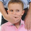 Man closes a mouth a hand to the boy — Stock Photo #7901798