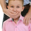 Man closes a mouth a hand to the boy — Stock Photo #7903520