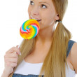 Happy curly woman with a lollipop — Stock Photo #7904094