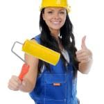 Beautiful young woman doing repairs — Stock Photo