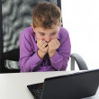 Boy at the computer — Stock Photo