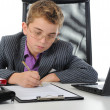 Young businessman using a laptop — Foto de Stock