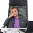 Young businessman using a laptop — Stock Photo #7905269