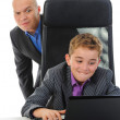 Young businessman using a laptop — Stok fotoğraf