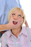 Man closes a mouth a hand to the woman — Stock Photo