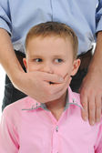 Man closes a mouth a hand to the boy — Stock Photo