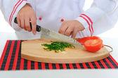Chef cuts the tomato — Stock Photo