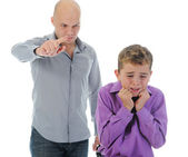 Strict father punishes his son — Stockfoto