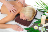 Young woman at spa procedure — Stock Photo