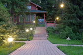 Evening at the cottage — Stock Photo