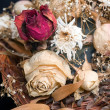 Stock Photo: Bouquet of withered flowers in a wicker basket