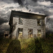 Old abandoned house with flying ghosts - Stock Photo