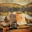 Fly fishing equipment  with vintage look - Stock Photo