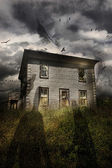 Old abandoned house with flying ghosts — Stock Photo