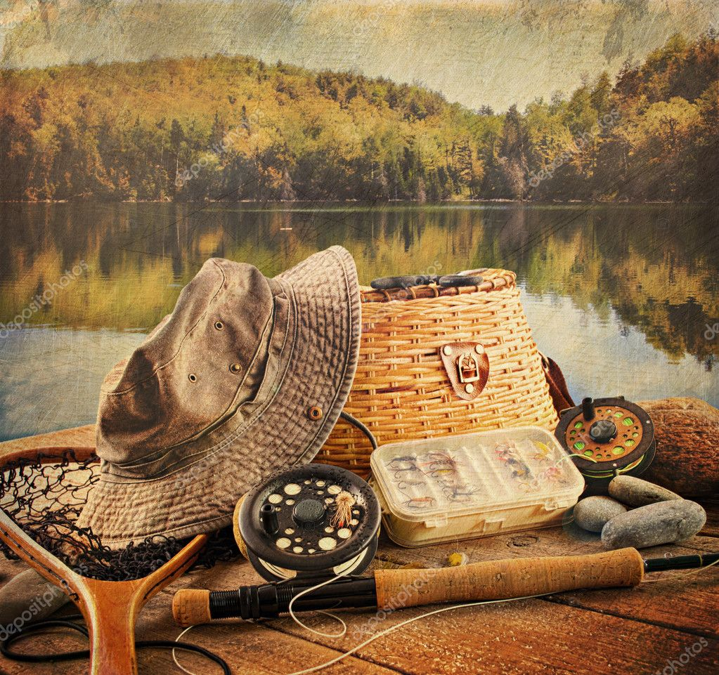 Fly fishing equipment on deck with a vintage look — Stock Photo #6845346