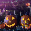 Halloween pumpkins in the grave yard - Stock Photo