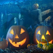 Stock Photo: Halloween pumpkins in the grave yard
