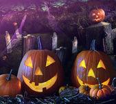 Halloween pumpkins in the grave yard — Stock Photo