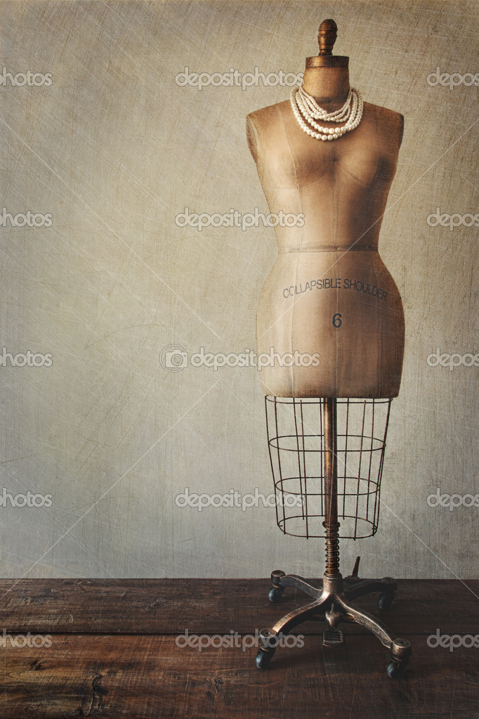 Antique dress form with vintage look background — Stockfoto #7006692