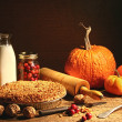 Still life of autumn fruits and and crumble pie — Stockfoto
