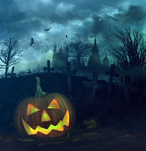 Halloween pumpkin in spooky graveyard — Foto Stock
