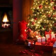 Christmas scene with tree and fire in background - Stok fotoğraf