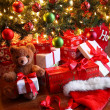 Gifts under the tree for Christmas - Stock Photo