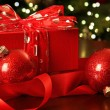 Red Christmas gift with ornaments - Stockfoto