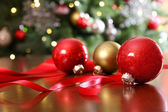 Red Christmas ornaments on a table — Stock Photo